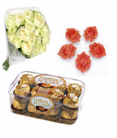 Luxury white roses with sweet Ferrero Rocher 16 pc and Designed Earthen Diyas Gifts toIndia, Combinations to India same day delivery
