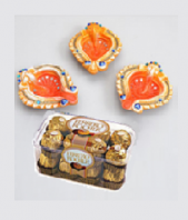 Orange Diyas and Ferrero Rocher 16 pc Gifts toIndia, Combinations to India same day delivery