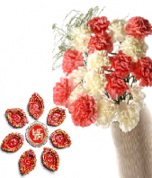 Ethnic Diyas and Pink and White Carnations