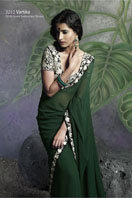 Bottle green saree with heavy embroidery blouse.